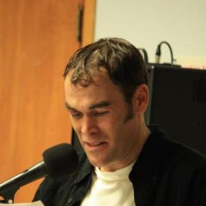 Mark Clarke giving a speech at Open Arms