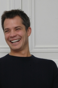 Timothy Olyphant laughing